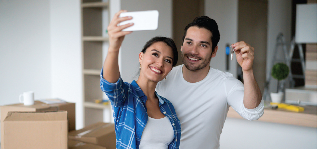 Young couple buy their first home