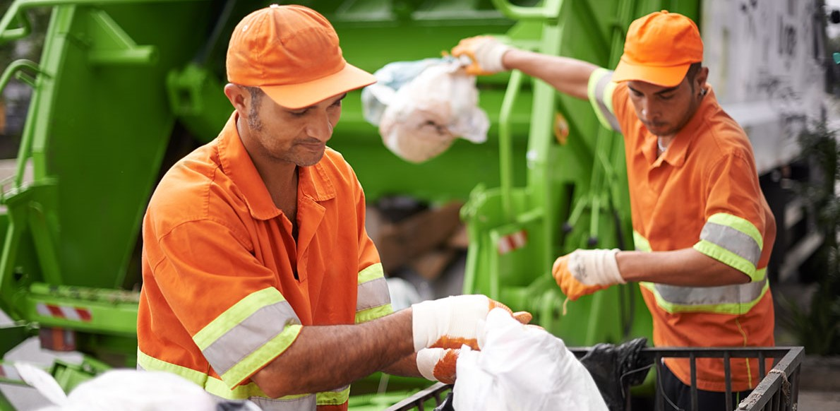 Two waste collectors at work